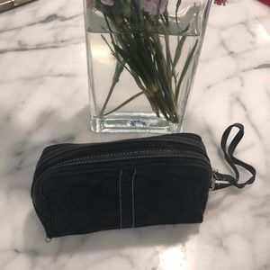 Black authentic Coach small cosmetic bag.